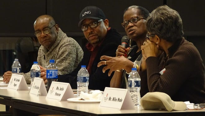 """Tara Dyer, center right, says she wants to see more black history and black interests reflected in Marion institutions and events. Dyer was among five black men and women who spoke Thursday at a panel called """"Growing Up Black in Marion"""" at The Ohio State University at Marion."""