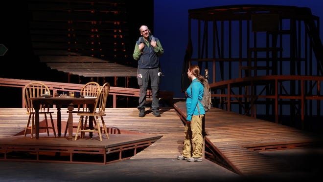 """Veronica Bissell performs with professional actor Dean Robinson in a scene from the NMSU Department of Theatre Arts and American Southwest Theatre Company's 2014 production of """"West Highland Way."""""""