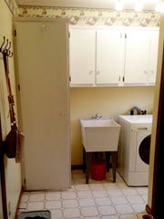 The laundry room before its makeover, complete with