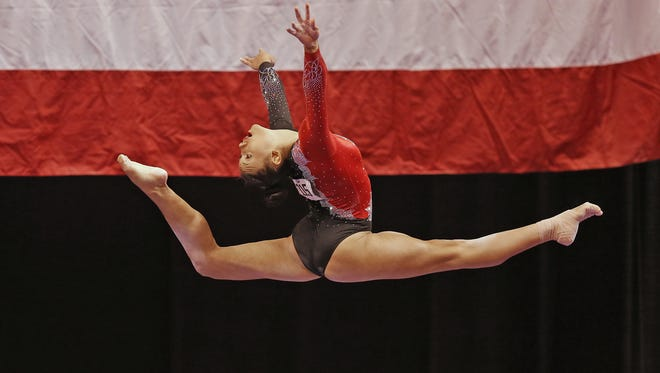 Kyla Ross leaps off the balance beam during the P&G Championships Senior Women's rounds, at Bankers Life Fieldhouse, Saturday, August 15, 2015.