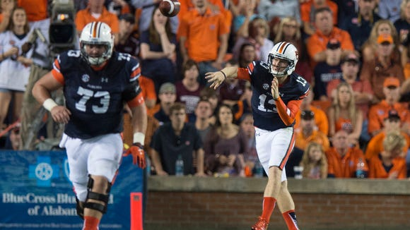 Auburn quarterback Sean White (13) throws a pass during the NCAA football game between Auburn and Mississippi State on Saturday, Sept. 26, 2015, at Jordan-Hare Stadium in Auburn, Ala. 