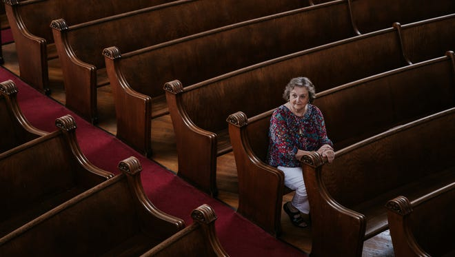 Ada Castleman of Pawleys Island, South Carolina sits in a pew while visiting the First Latin American Baptist Church in Detroit's Delray community on Thursday August 11, 2017 where she used to sit hoping that her late husband would come and sit next to her when she was younger.
