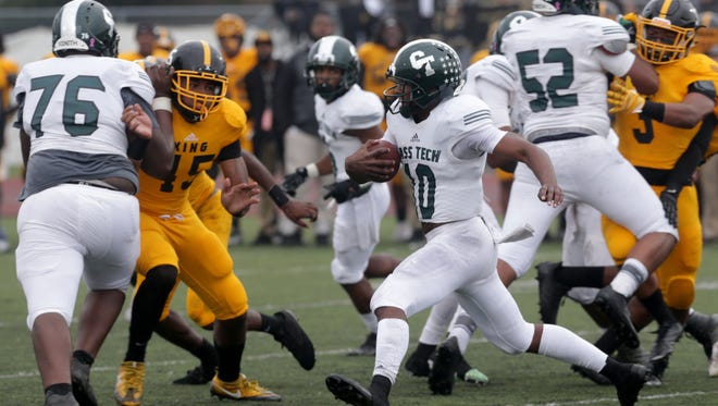 Detroit Cass Tech quarterback Aaron Jackson scrambles out of the pocket through a hole made by his offensive line during the first half of the Detroit Public School League semifinal at Detroit Northwestern on Saturday, Oct.14, 2017. King won the game, 17-7.