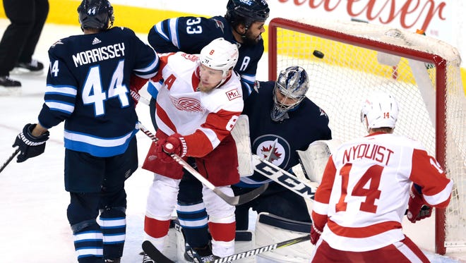 Detroit Red Wings defenseman Niklas Kronwall (not shown) scores in the first period on Winnipeg Jets goaltender Connor Hellebuyck (37) at Bell MTS Place on Friday, March 2, 2018.