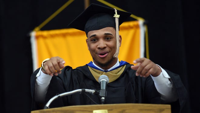 Michael Whitley speaking at Lakeland University's graduation commencement.