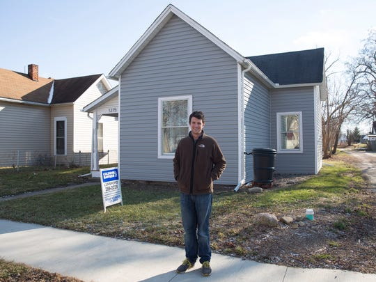 Craig Graybeal stands in front of 1215 W. 10th St., a meth-contaminated house rehabbed by the non-profits ecoREHAB and the Ball Brothers