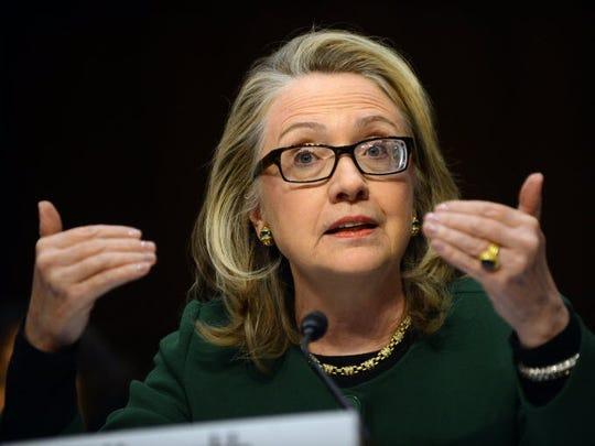 Then-secretary of State Hillary Clinton testifies on