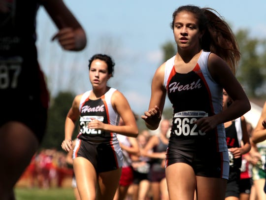 Heath's Adrienne Collier, right, and Kyra Herring compete