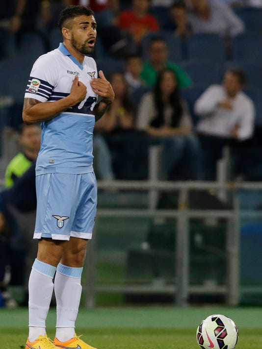 Lazio's Mauricio reacts after receiving a red card by referee Davide Massa during a Serie A soccer match between Lazio and Inter Milan at Rome's Olympic stadium, Sunday, May 10, 2015. (AP Photo/Gregorio Borgia)