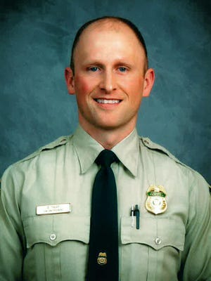 This undated photo provided by the U.S. Forest Service shows Forest Service law enforcement officer Brad Treat, who was attacked and killed by a bear in Glacier National Park on June 29, 2016.