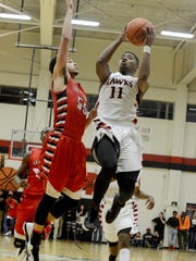 South Side's Chris McNeal goes up for a shot as Lexington's Jordan Branch defends him.