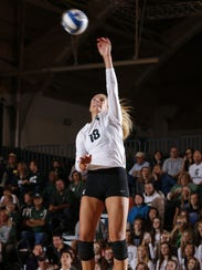 Michigan State's Holly Toliver serves against Michigan