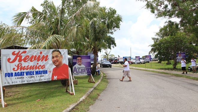 Campaign supporters at the entrance to Oceanview Middle School greet passing vehicles during the election for the Agat Vice Mayor on Saturday, June 6.