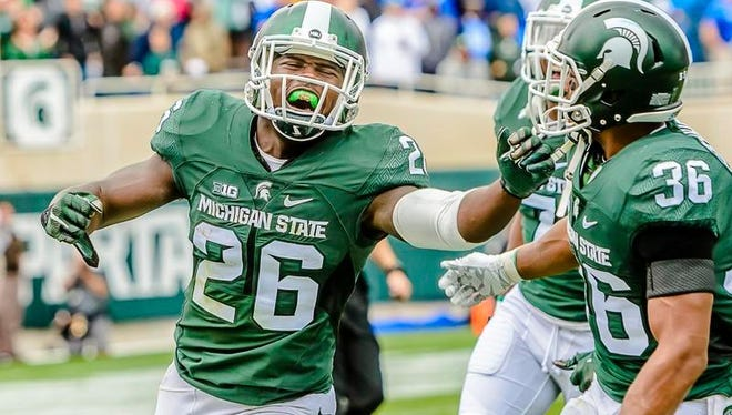 RJ Williamson ,26, of MSU celebrates after intercepting a pass meant for Ryan Reffitt of Air Force on a 3rd and goal at the MSU 10 yard line in the 4th quarter of their game Saturday September 19, 2015 in East Lansing.