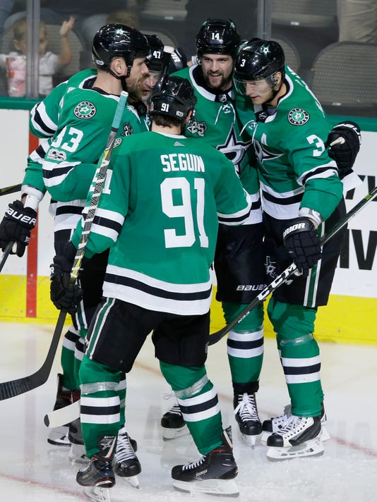 Dallas Stars left wing Jamie Benn (14) celebrates with teammates Tyler Seguin (91), John Klingberg (3), Marc Methot (33) and Alexander Radulov (47) after scoring a goal during the second period of an NHL hockey game against the Colorado Avalanche in Dallas, Saturday, Oct. 14, 2017. (AP Photo/LM Otero)
