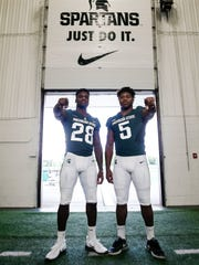 MSU's David Dowell, left, and twin brother Andrew Dowell, pictured Aug. 7, 2017, at the Skandalaris Football Complex in East Lansing.
