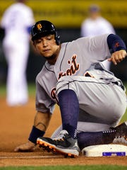 Tigers first baseman Miguel Cabrera slides safely into