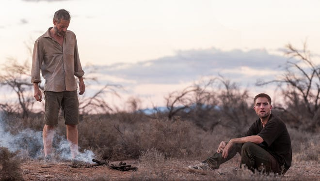 """Guy Pearce (left) and Robert Pattinson in a scene from the film, """"The Rover."""""""