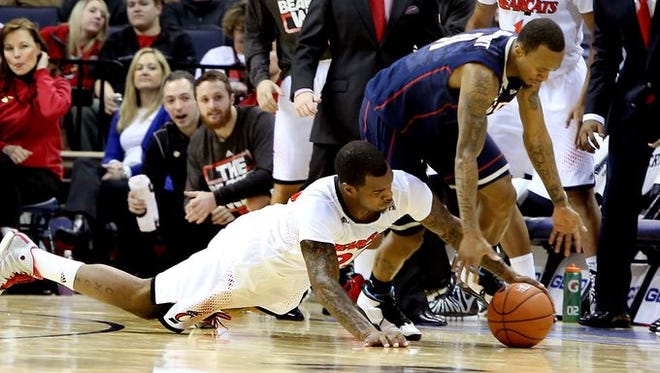 Sean Kilpatrick and Shabazz Napier fight for a loose ball on Friday night.