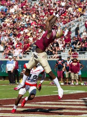 The 56 points scored in the first half by Florida State tie a program best for points scored in a half.