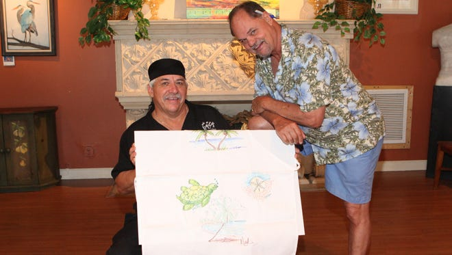 Craig Kingston, left, owner of Taste Casual Dining with artist Dan Mackin, founder of White Shirt Night, prepare for Helping People Succeed's 2018 event June 23 in Hobe Sound.