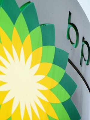 File photo taken in 2011 shows the sign of British energy giant BP at a filling station in London, England.