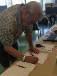 """Ken McGraw votes after donating blood. """"I like them"""