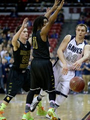 Xavier's Sam Burkart (right) is locked in by Brown