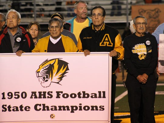 Members of the 1950 Class B state championship team were honored during halftime Friday night at Tiger Stadium.