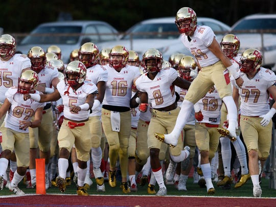 Bergen Catholic takes the field at the start of the game against Don Bosco in Granatell Stadium in Ramsey on Friday, Oct. 27, 2017. Bergen Catholic won the NJSFC United Red rivalry game, 29-26.