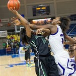 Ville Platte's Miya McKinney Mansfileld's Keiona Ross as she drives for a shot during the LHSAA Class 3A high school basketball semifinal game at Burton Coliseum in Lake Charles.