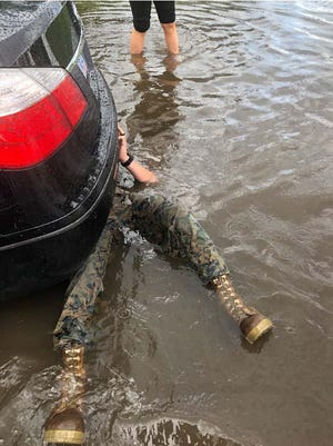 Marine Sgt. Benjamin Reinoldt from Camp Lejeune 2nd LAR recently helped a woman whose car was caught in the recent flash flood waters and towed her car home.