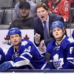 Toronto Maple Leafs coach Mike Babcock yells behind the bench against the Ottawa Senators on Monday, Sept. 21, 2015.