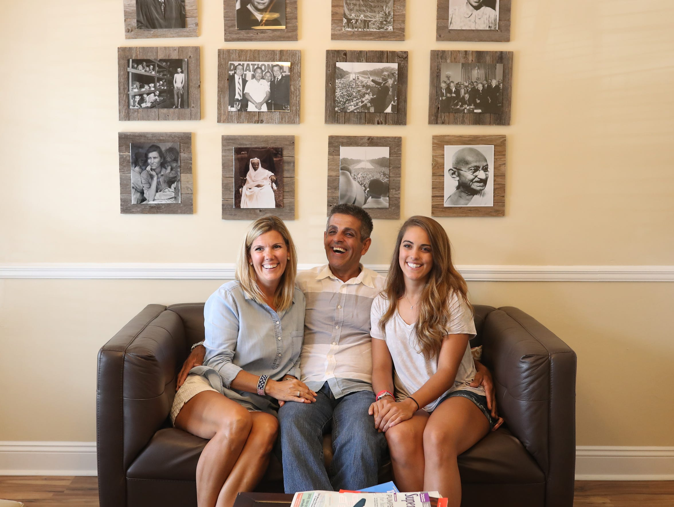Rudy and Shelly Blanco laugh with their daughter Hannah