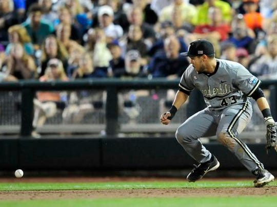 Vanderbilt first baseman Zander Wiel errors during the 6th inning against Virginia in the Game 2 of the College World Series finals at TD Ameritrade Park, Tuesday, June 23, 2015, in Omaha, Neb.