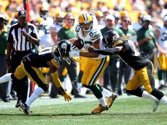Aug 23, 2015; Pittsburgh, PA, USA; Green Bay Packers wide receiver Jeff Janis (83) runs after a pass reception as Pittsburgh Steelers defensive back Antwon Blake (41) and strong safety Shamarko Thomas (29) defend during the second quarter at Heinz Field. Mandatory Credit: Charles LeClaire-USA TODAY Sports