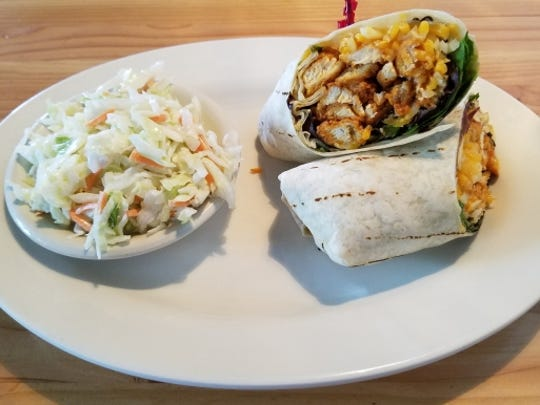 Lures' Buffalo chicken wrap was fried chicken in a Buffalo sauce with spring mix and cheddar Jack cheese blend. The side of coleslaw was added for no extra charge.