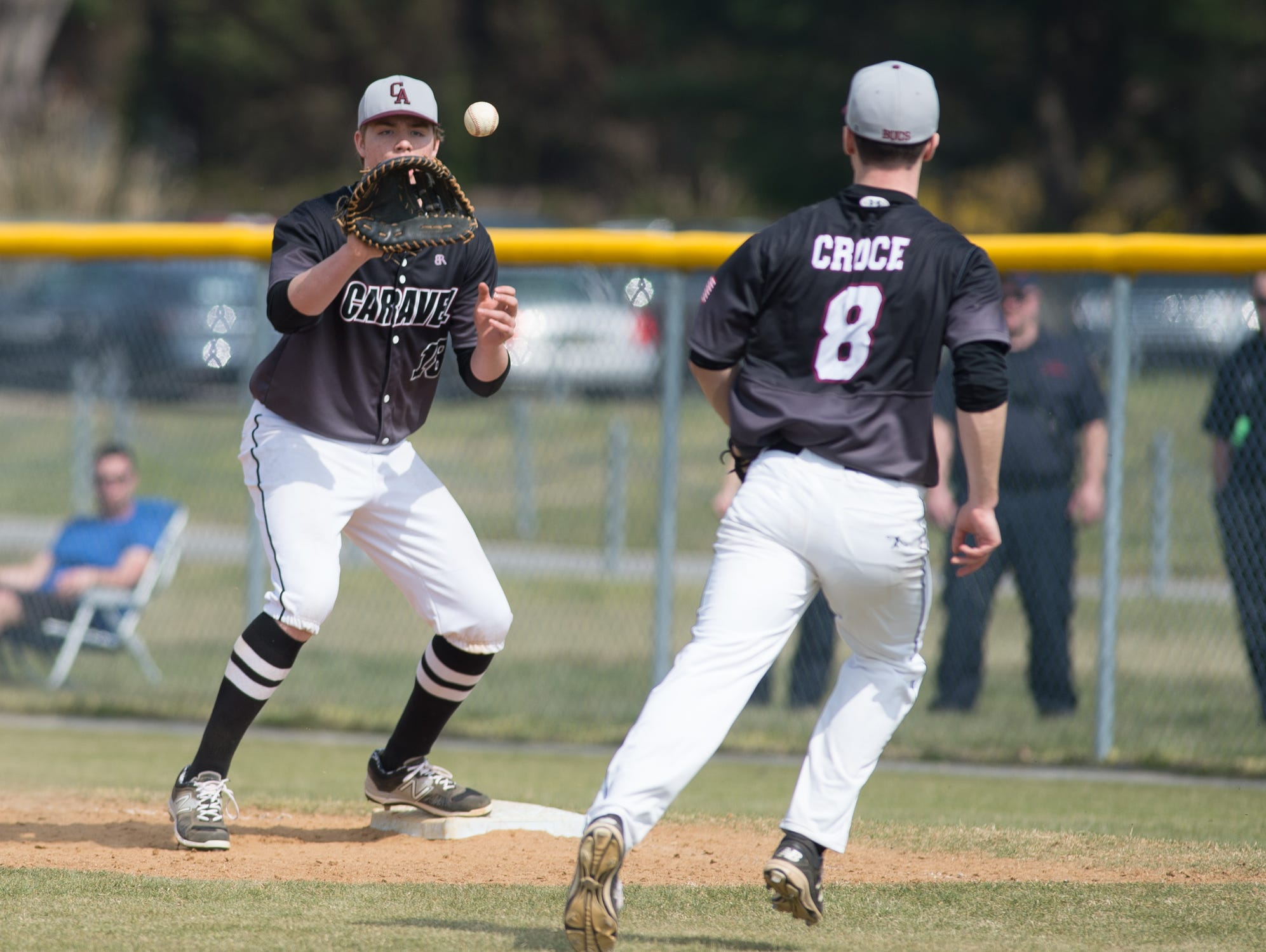 Caravel's Tyler Croce (8) throws to Cole Reynolds for the final out of the second-ranked Buccaneers' 11-10 baseball win at fourth-ranked Cape Henlopen on Saturday.