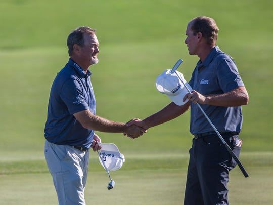 Jerry Kelly (left) shakes hands with Steve Stricker at the end of their round during the Chubb Classic in Naples on Friday, February 16, 2018.