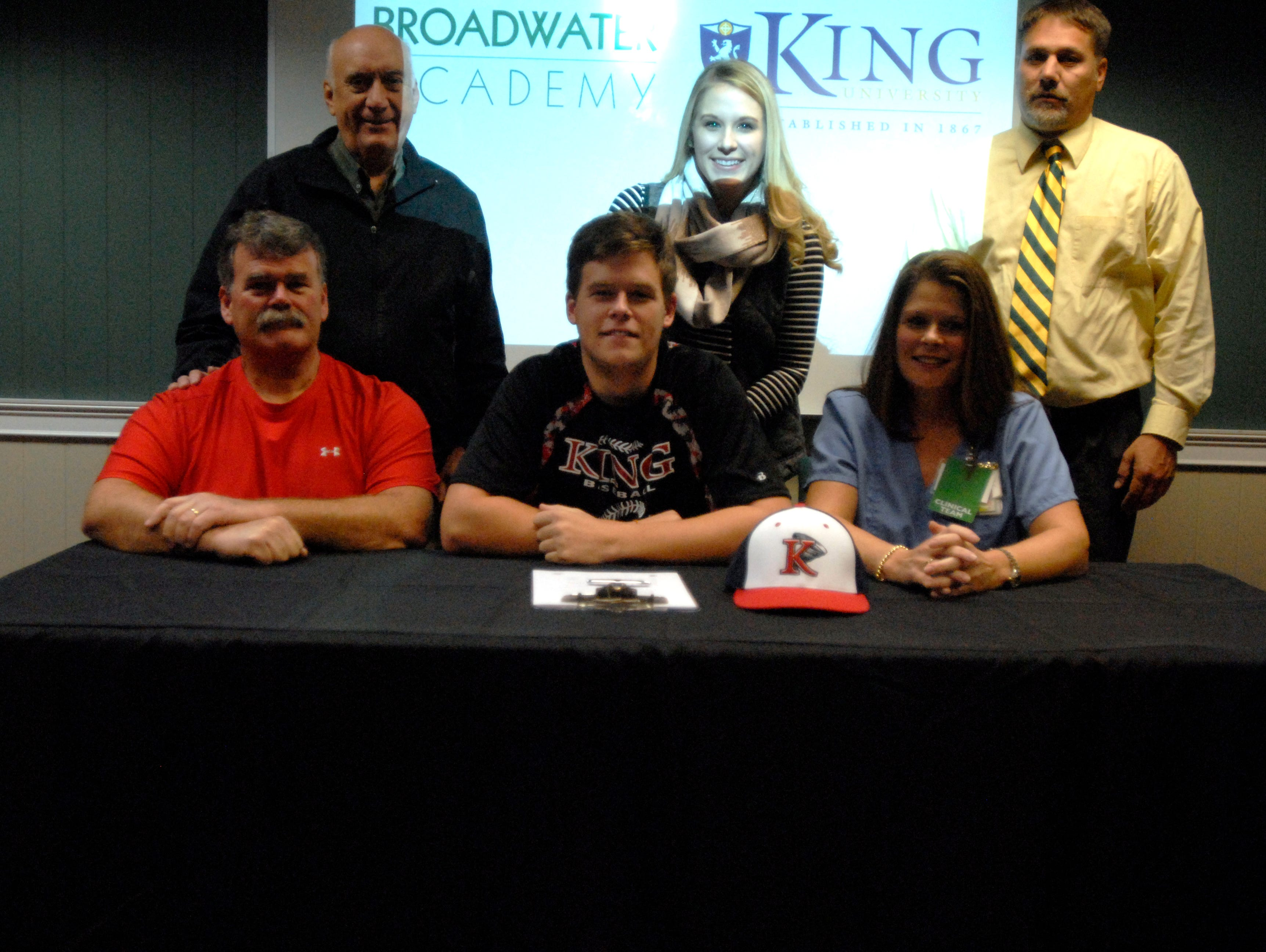 Broadwater Academy senior Ben Farlow, middle bottom row, poses after signing his letter of intent to play baseball at King University in Bristol, Tenn. Thursday, Nov. 12, 2015. Also pictured, from left bottom row, Farlow's father Charlie, Farlow, Farlow's mother Susan; from left top row, Broadwater Headmaster Joe Spagnolo, Farlow's sister Abby and Broadwater Athletic Director Ron Anson.
