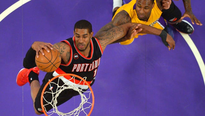 Portland Trail Blazers forward LaMarcus Aldridge, left, grabs a rebound away from Los Angeles Lakers forward Tarik Black during the first half of an NBA basketball game, Friday, April 3, 2015, in Los Angeles.