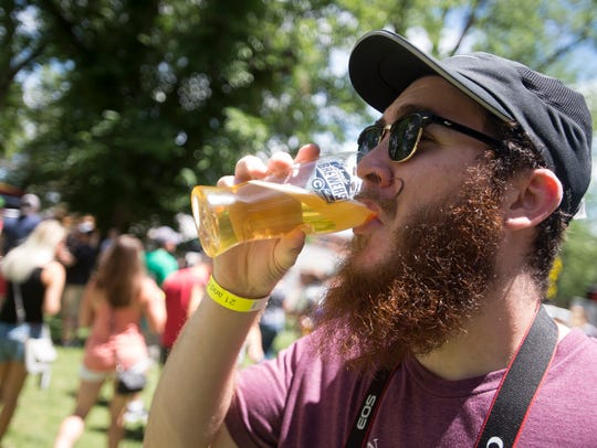 Dylan Hochstedler sips a beer at the Colorado Brewers'
