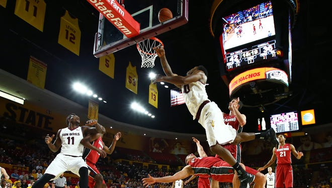 ASU guard Shaquielle McKissic (40) shoots the ball over Stanford Cardinal forward Reid Travis in the second half at Wells-Fargo Arena. The Sun Devils defeated the Cardinal 67-62.