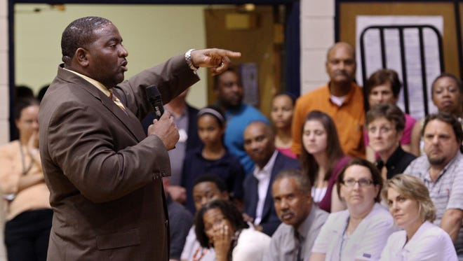 Spurgeon Banyard speaks to parents in October 2012, shortly after becoming principal at Carencro Middle.