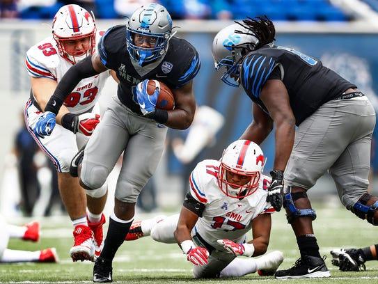 Memphis running back Patrick Taylor, Jr. (left) scrambles