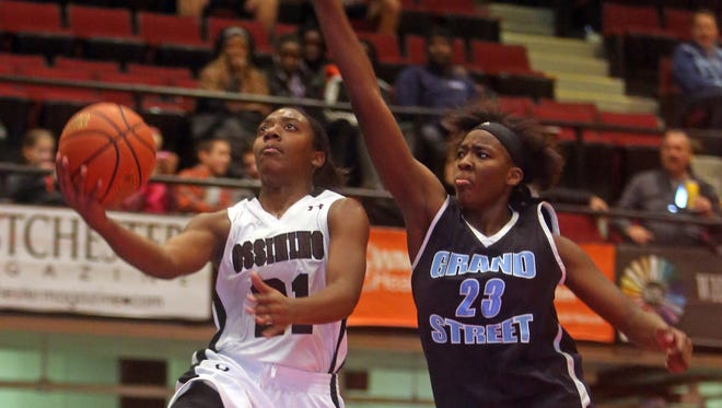 Ossining's Shadeed Samuels drives past Shanique Edwards of Grand Street Campus during the Slam Dunk Tournament at the Westchester County Center in White Plains Dec. 26, 2015.   Ossining defeated Grand Street 75-67.