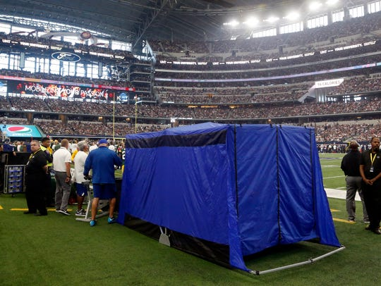 A pop-up medical tent is shown on the sideline during