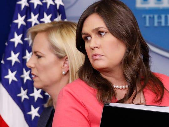 Homeland Security Secretary Kirstjen Nielsen, left,