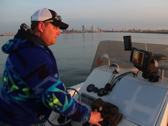 Brian Settele of Menomonee Falls monitors his sonar