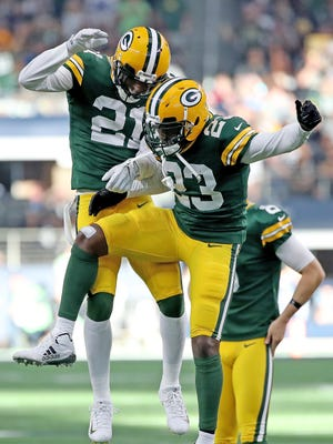 Green Bay Packers cornerback Damarious Randall (23) and free safety Ha Ha Clinton-Dix (21) celebrates Randall's pick six against the Dallas Cowboys Sunday, October 8, 2017 at AT&T Stadium in Arlington, Tx.
